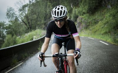 Female race cyclist on mountain road