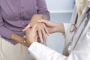 General practitioner examining a patient's hand