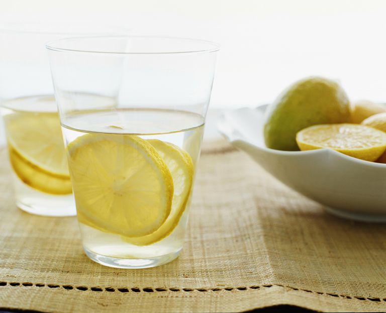 Lemon water with lemon slices, close-up
