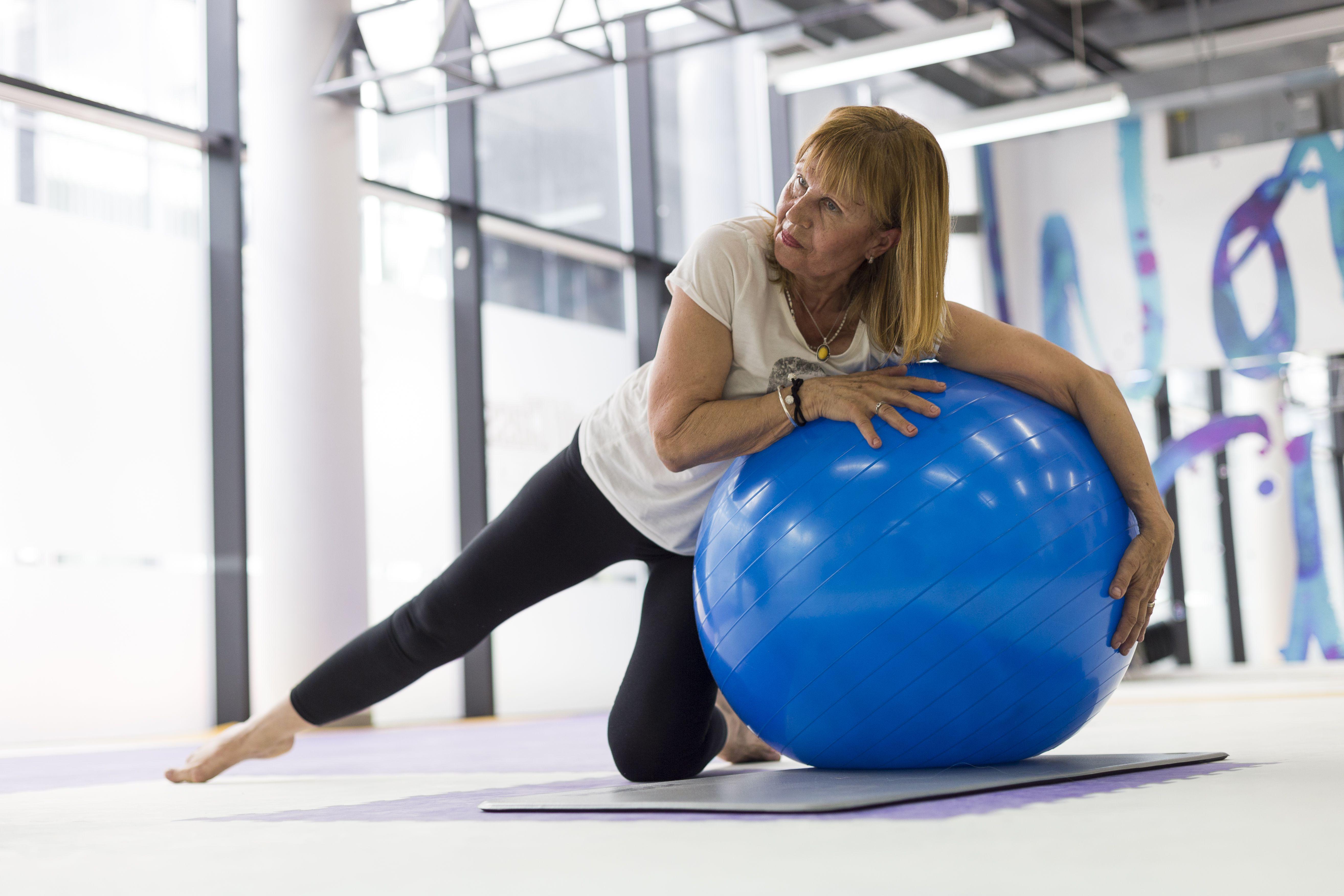 Senior woman exercising in gym