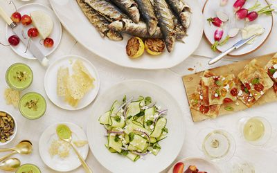 Tablescape with fish, vegetables, and smoothies