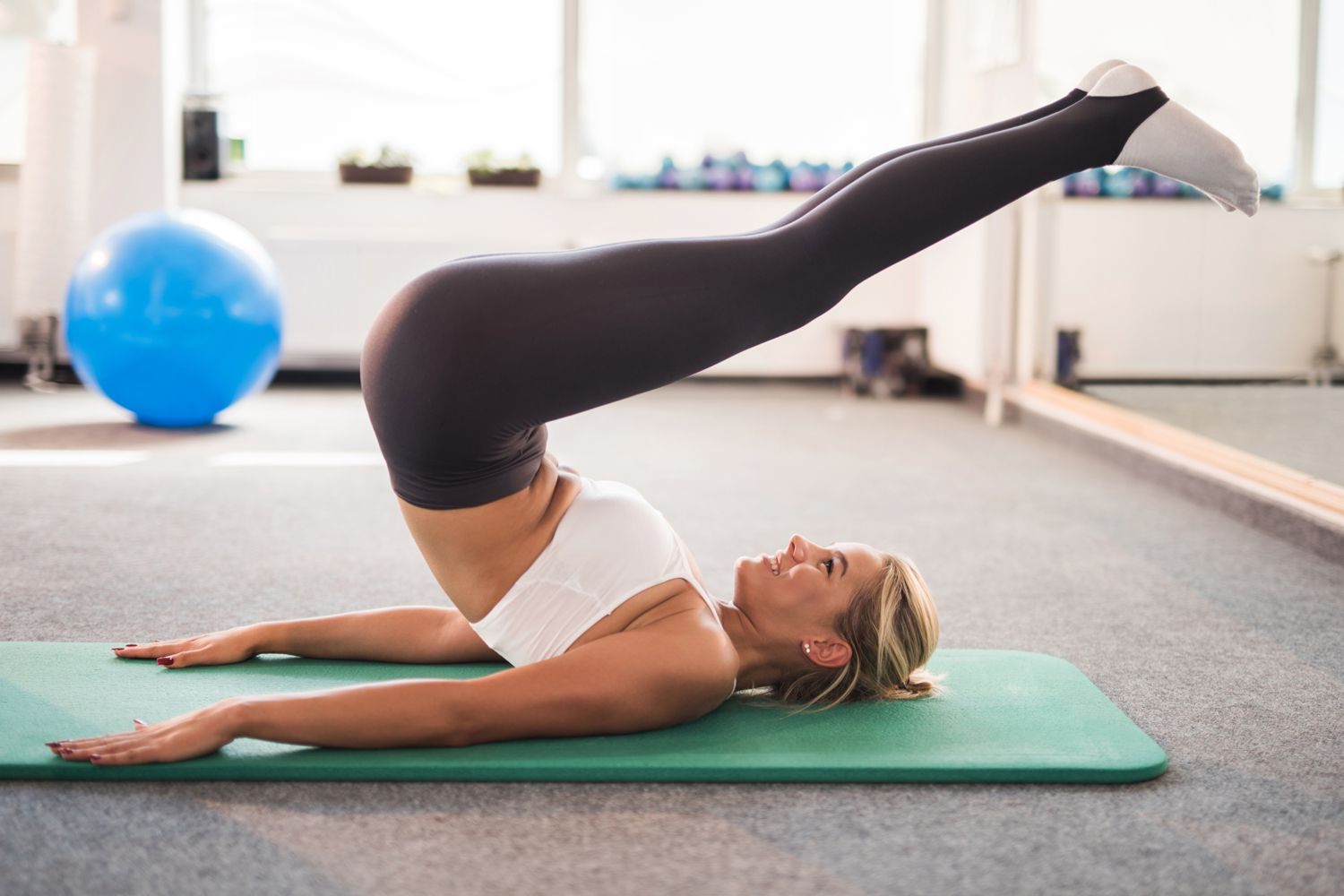 woman doing the Pilates roll over