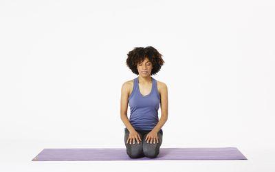 Woman on yoga mat showing ocean breath