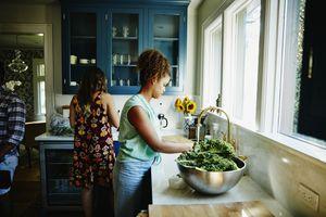 woman washing kale