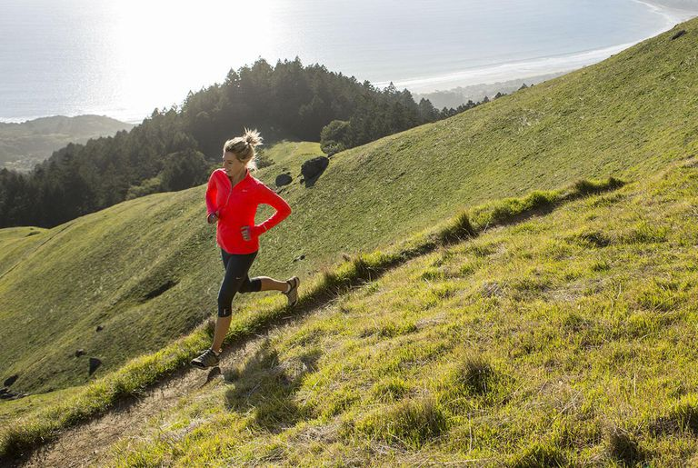 Trail running amongst green rolling hills.