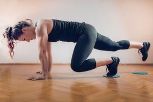 Female Athlete Exercising with Sliding Discs