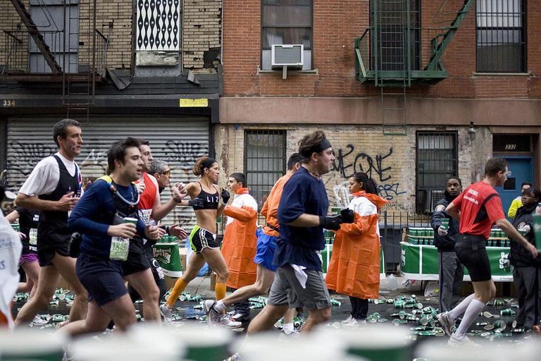 View of runners on NYC marathon course from a water station