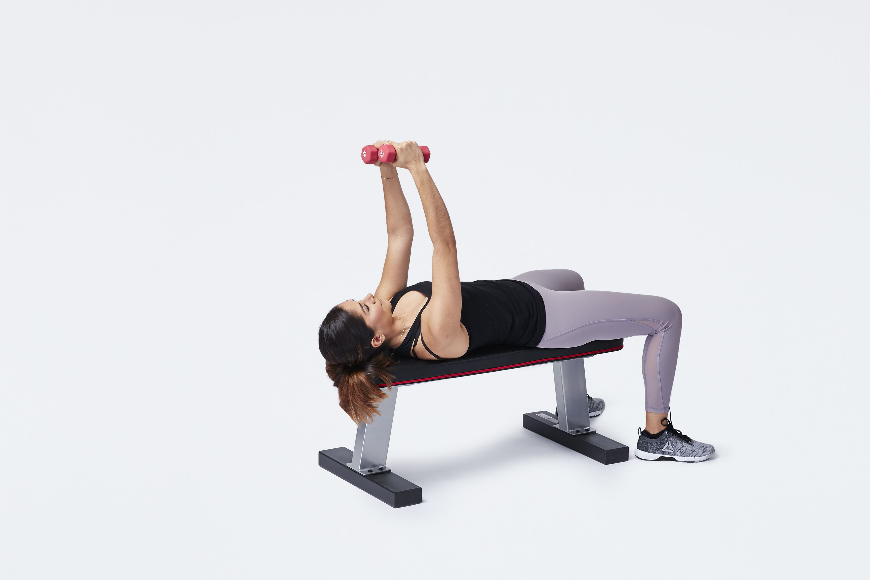 woman doing chest fly