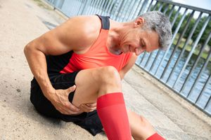 Close-up Of A Mature Man With Sprained Thigh Muscle