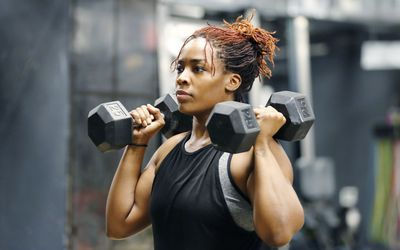 Woman working out with hand weights