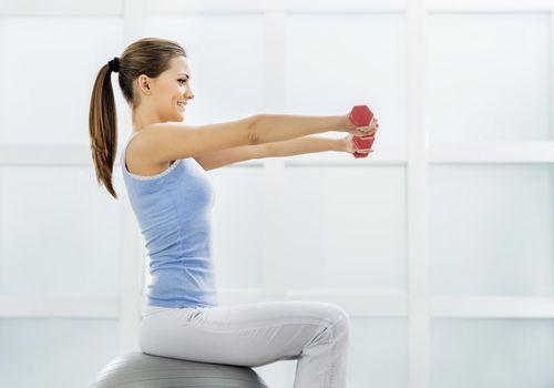 Smiling woman exercising.