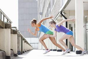 Two women sprinting