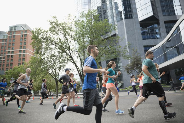 Marathon runners running on urban street