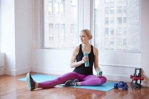 Woman sitting in exercise studio
