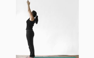Woman in urdhva vriksasana yoga pose