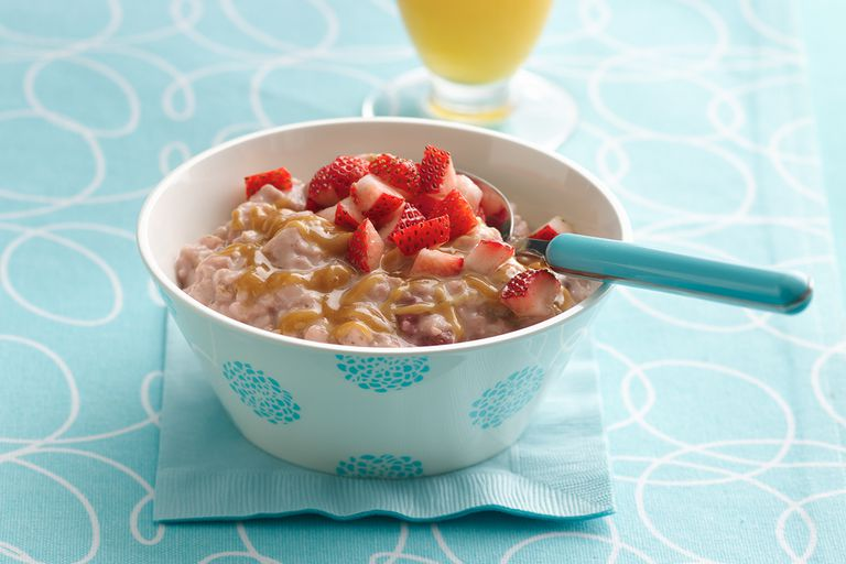Bowl of oatmeal with peanut butter and strawberries