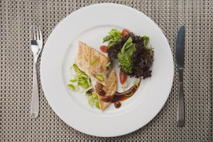 overhead shot of plate of salmon with salad