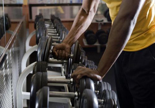 Man taking weights from rack