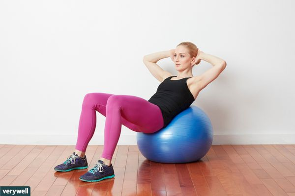 woman doing exercise ball crunches
