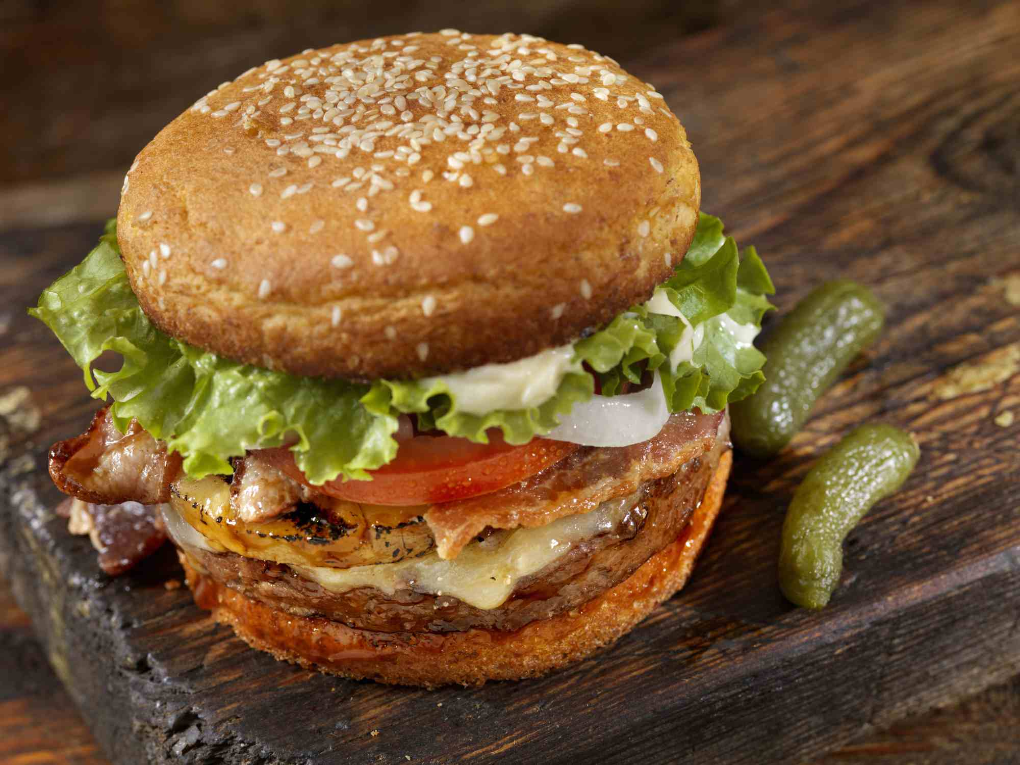 Bacon burger on cutting board