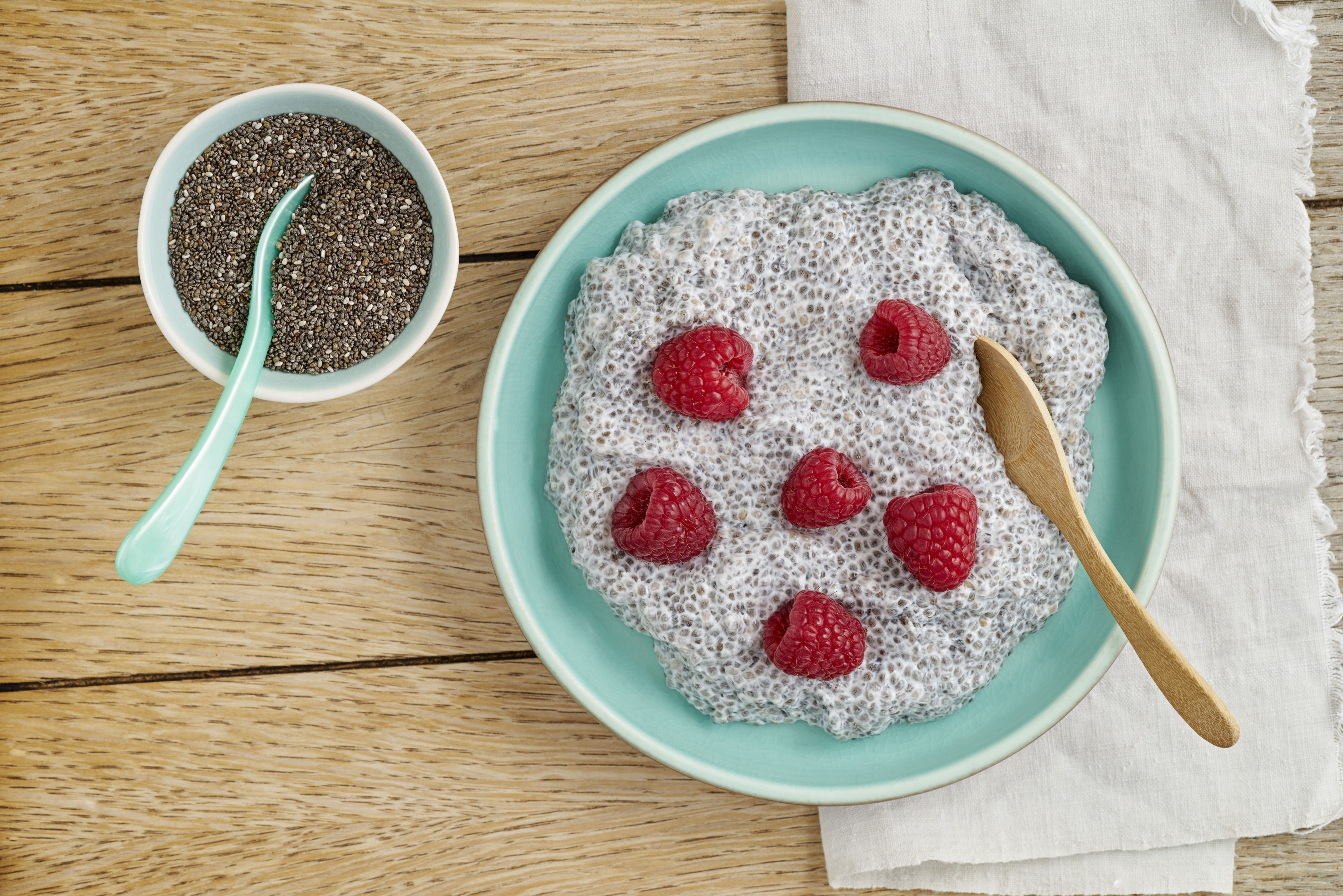 Chia pudding made of chia seeds with almond milk and raspberries