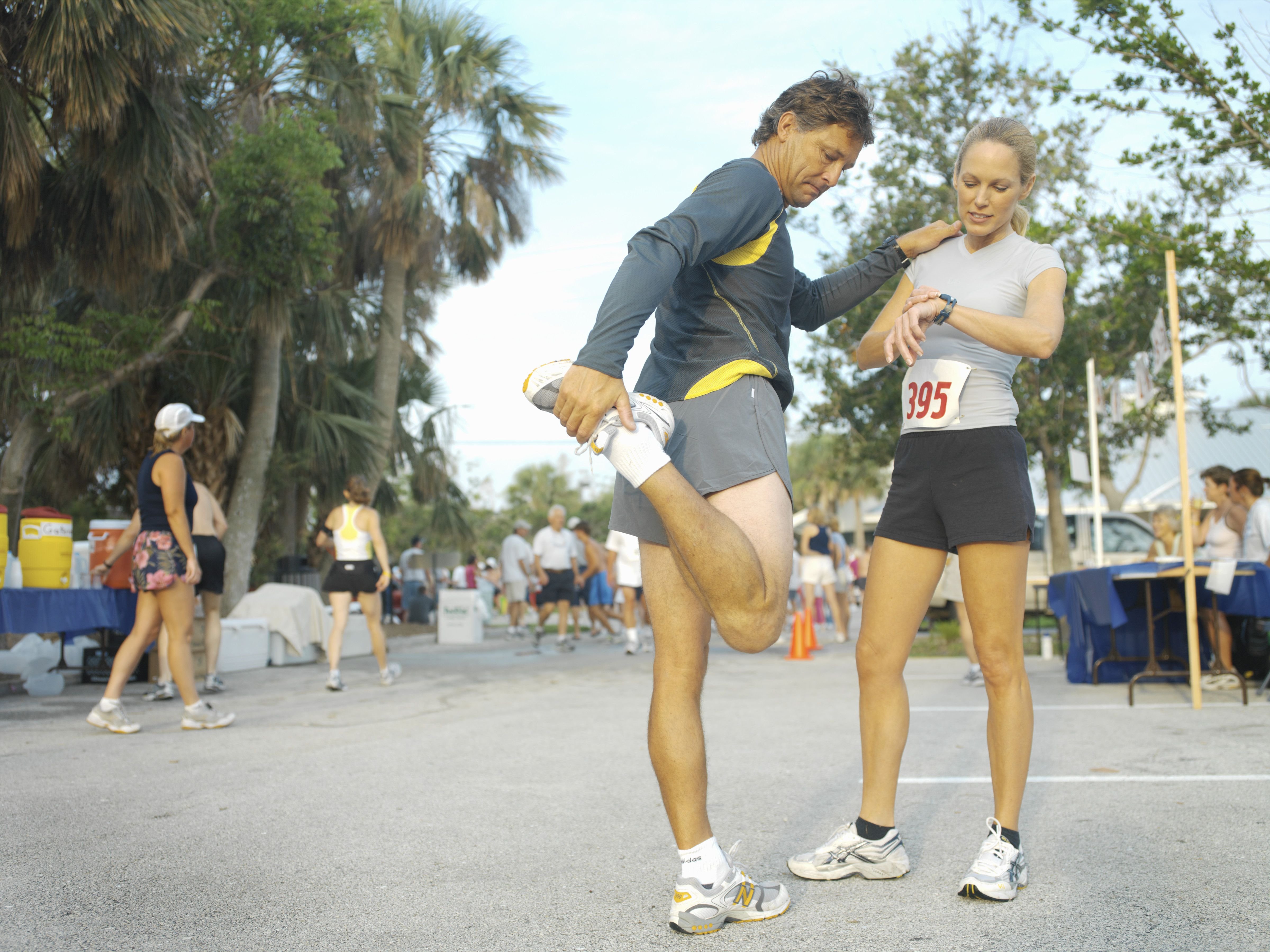Runners stretching before race