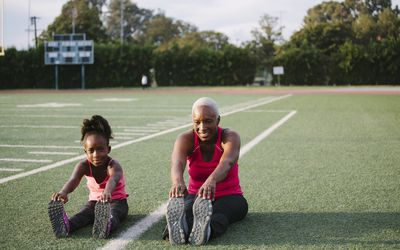 Woman and girl exercising