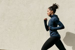 side view of woman running