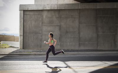 Woman running on a road
