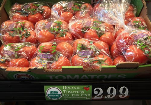 Packages of organic tomatoes on the vine