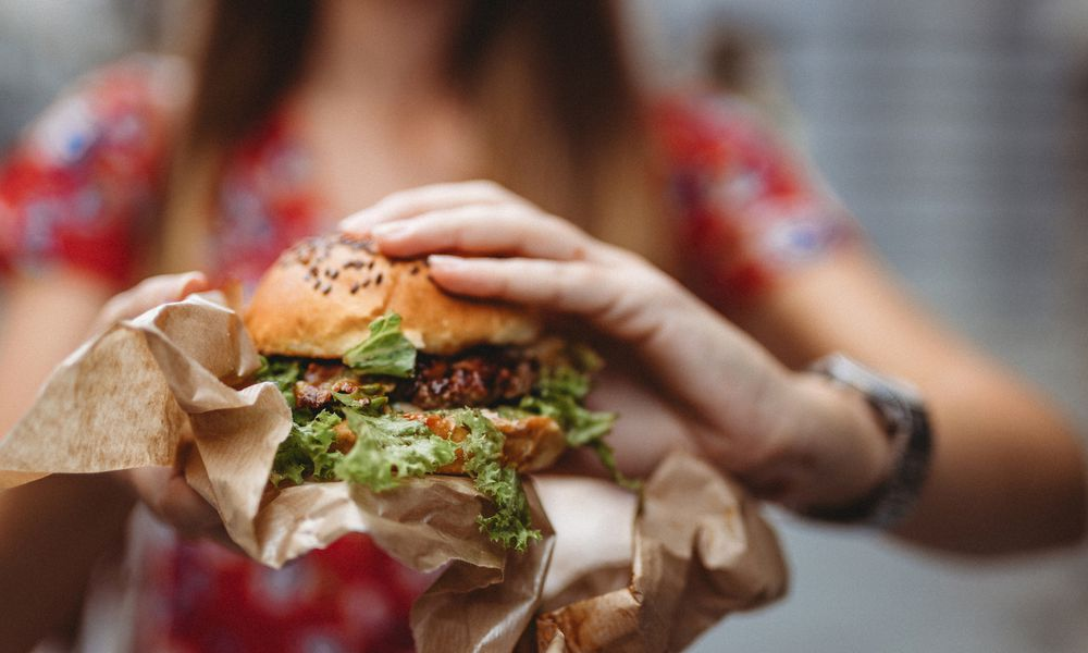 woman holding a veggie burger