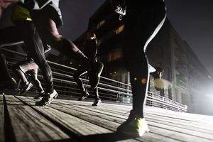 small group of runners in urban invironment, evening training