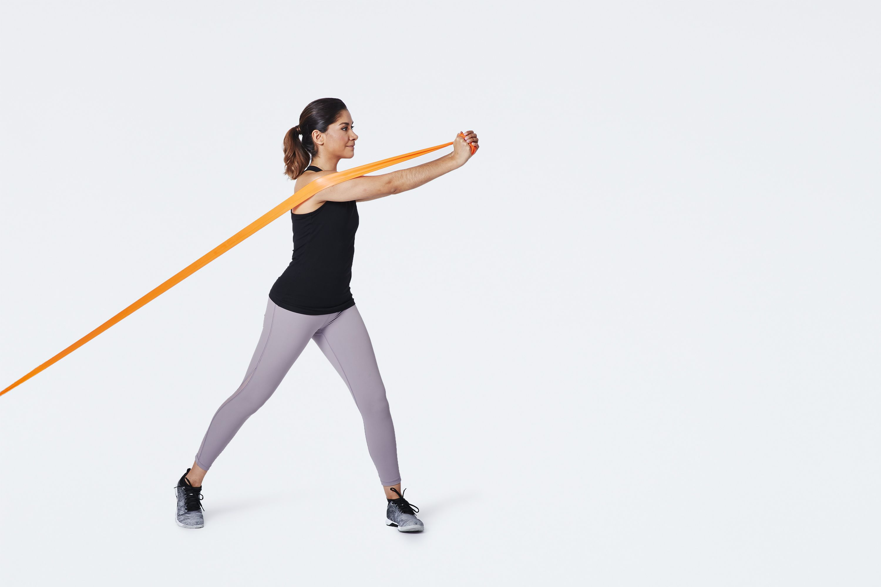 woman doing reverse woodchop with resistance band