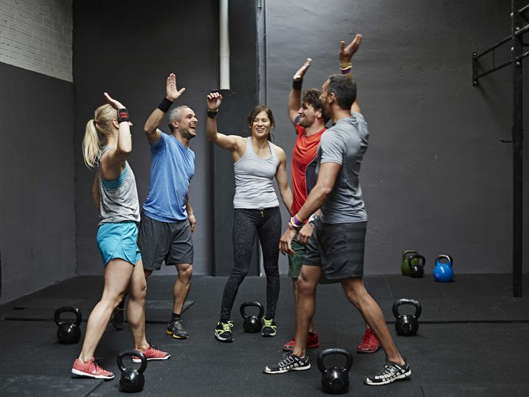 Group high-fiving at a boutique gym