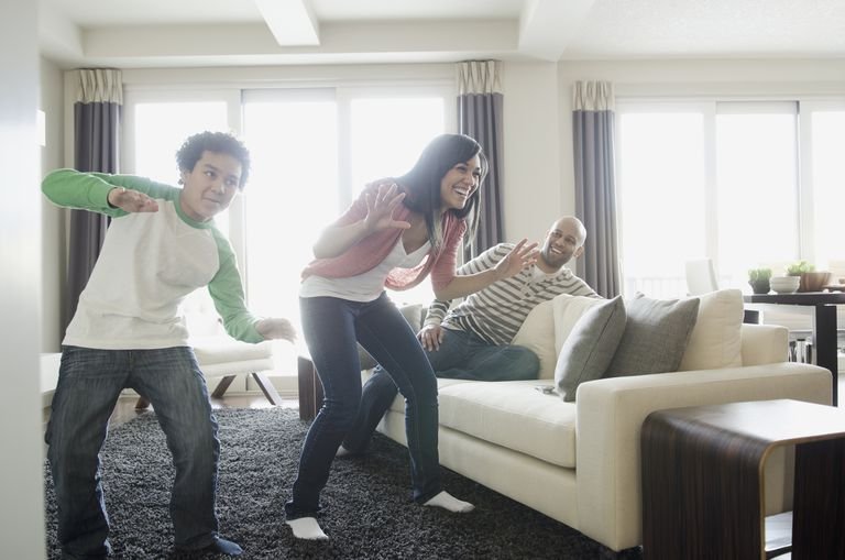 family playing dance video game