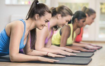 Four women exercising in gym
