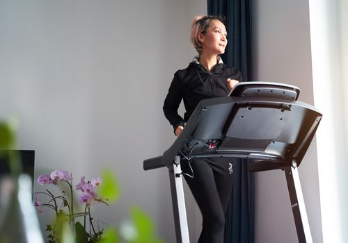 woman exercising on treadmill home gym