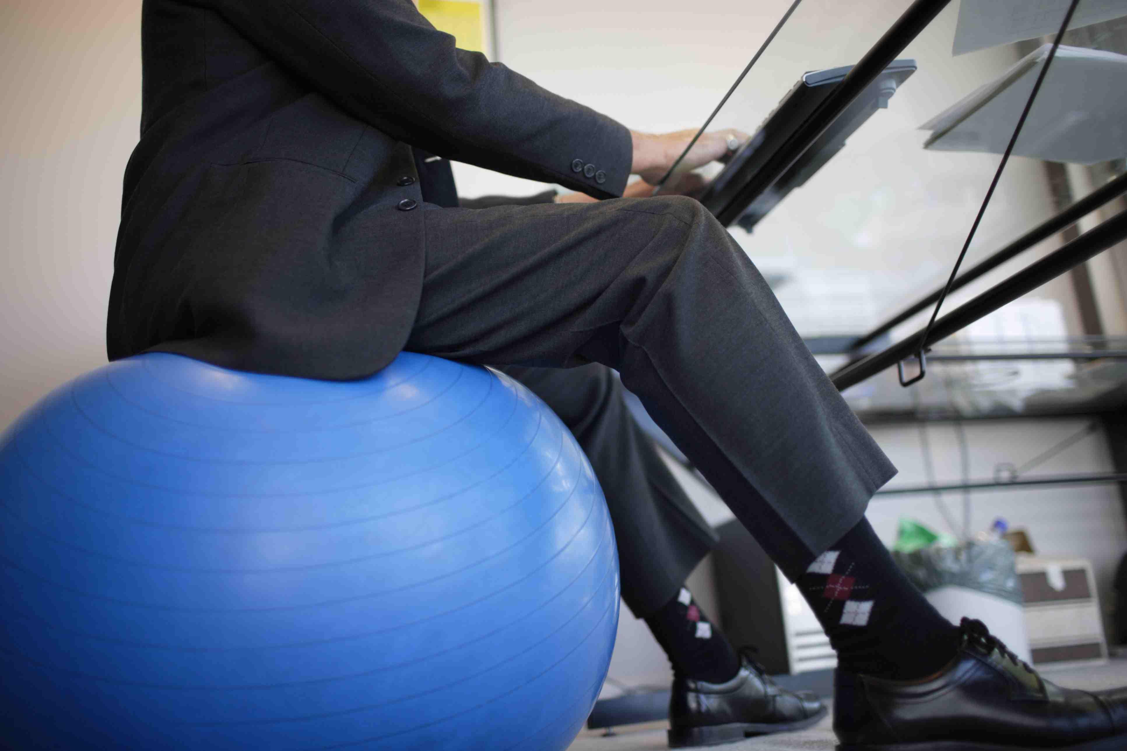 Man Using an Exercise Ball as a Desk Chair
