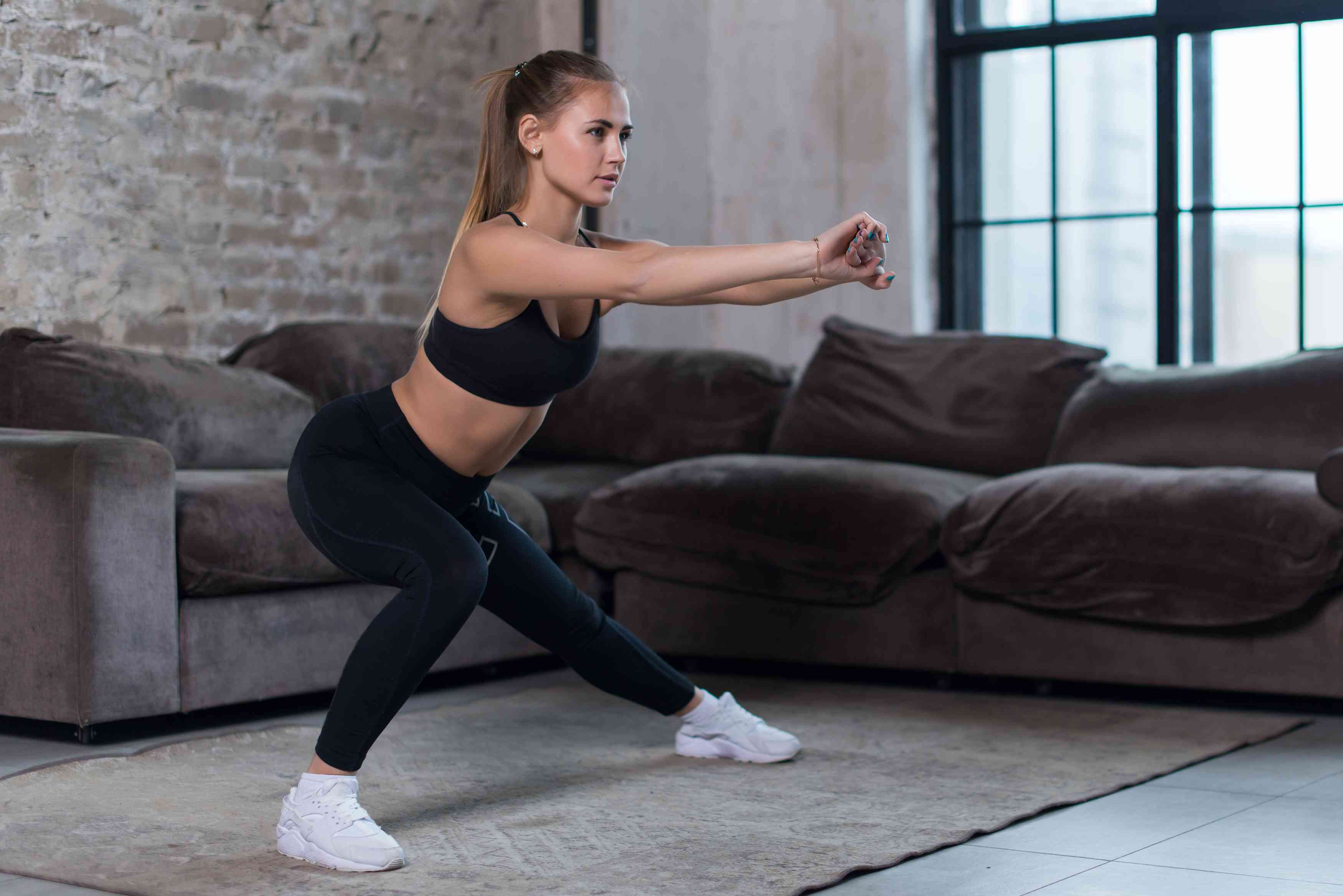 woman doing side lunge exercise