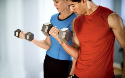 man and woman doing bicep curls