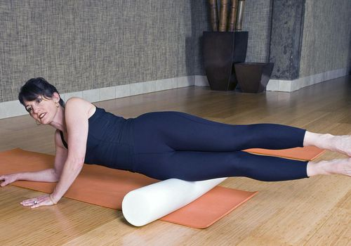 Woman working her legs with a pilates roller. Click below for more in this series plus my other working out and staying fit images: