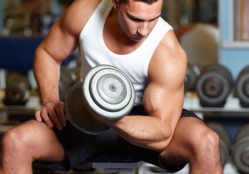 man building his biceps