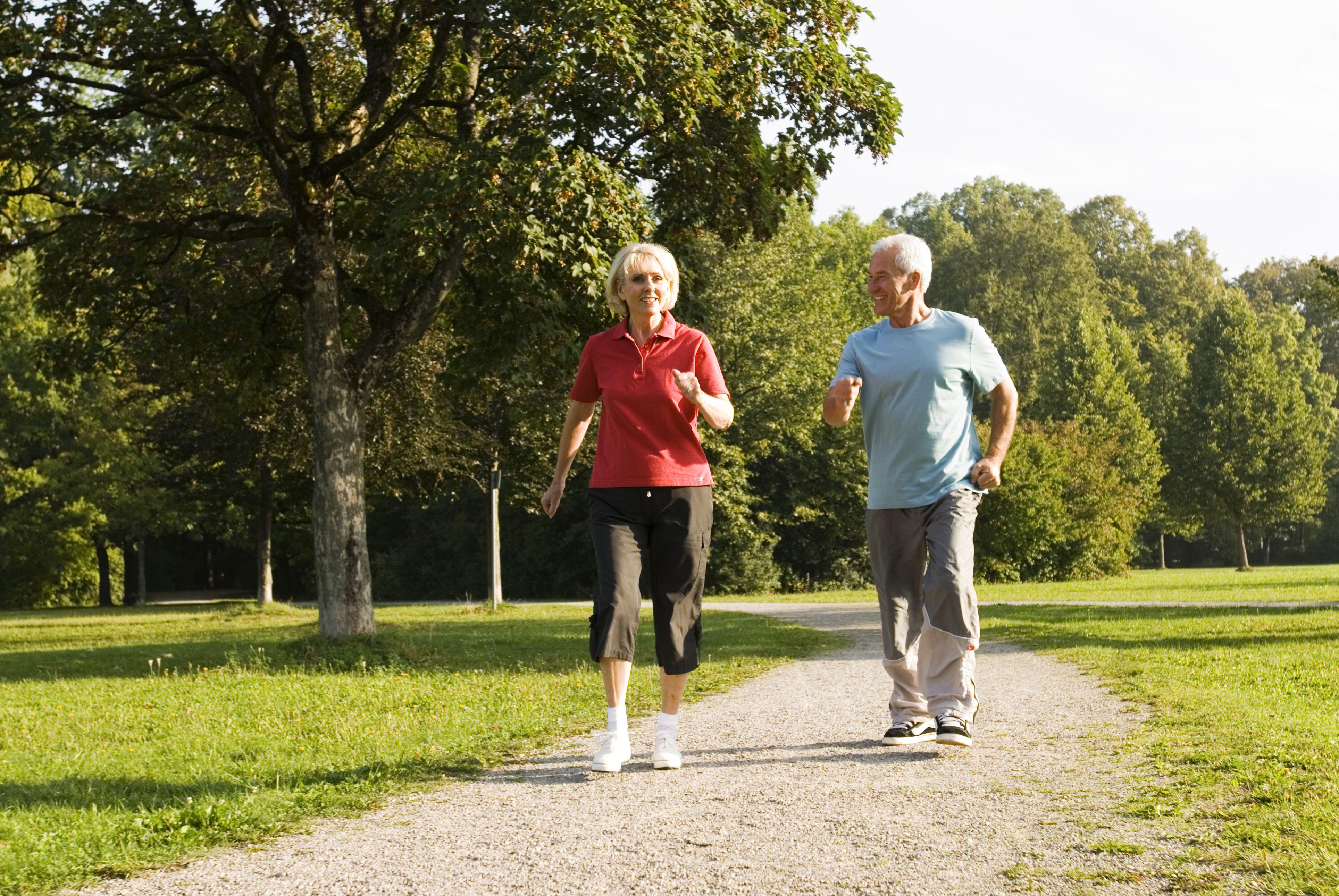 Couple Walking Briskly in Park