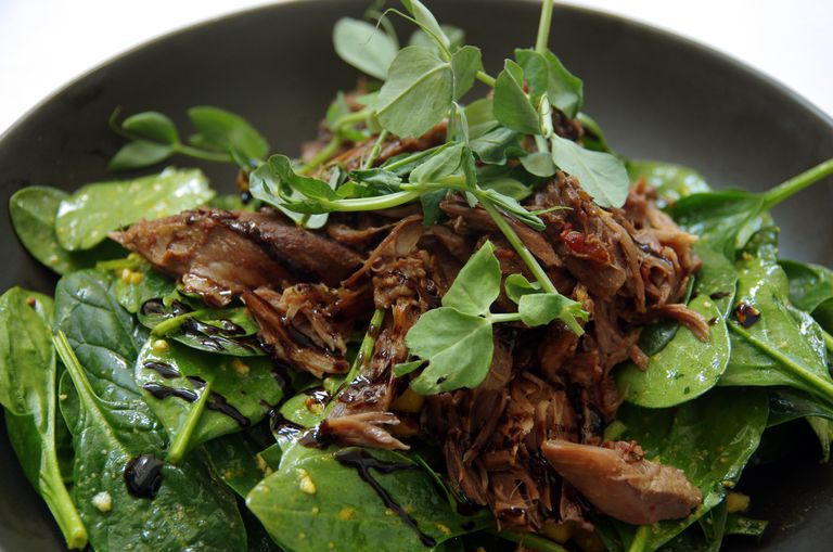 Slow cooked lamb, spinach, bean shoots and chickpea salad with balsamic vinegar dressing
