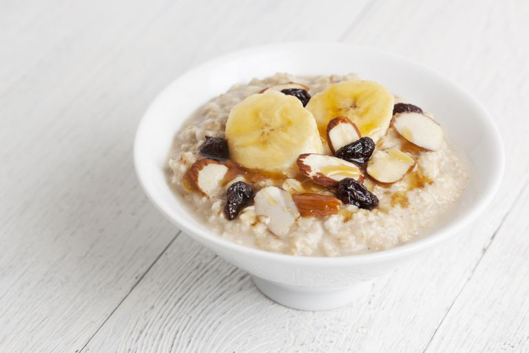 Bowl of oatmeal with fruits and nuts on top