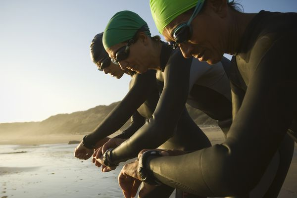 triathletes looking at watches