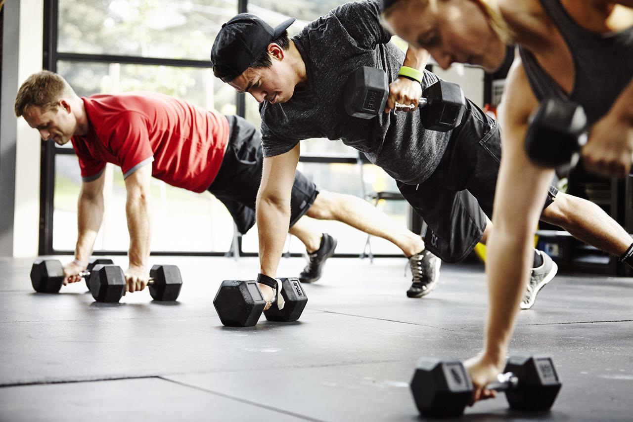 Men in gym using weights