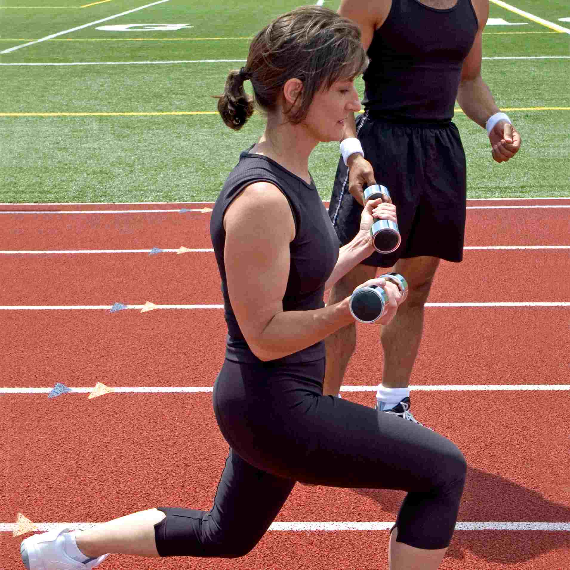 Outdoor Workout on Track with a trainer