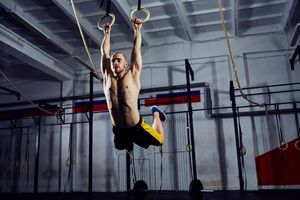 A CrossFit athlete performs a muscle-up.