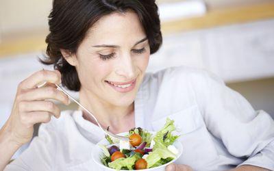 healthy eating habits - woman eating salad